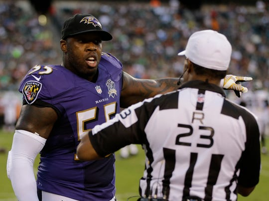 Baltimore Ravens linebacker Terrell Suggs, left, talks with referee Jerome Boger during a preseason game against the Philadelphia Eagles on Saturday, Aug. 22, 2015, in Philadelphia.