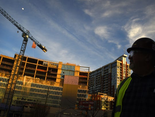Construction worker Howard Clark is on the site of the construction boom in the Gulch area of Nashville. He is working on the Thompson Hotel in the background.