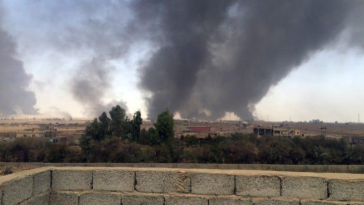 Smoke rises during fighting between Iraqi security