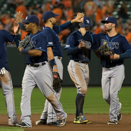 Aug 27, 2014; Baltimore, MD, USA; Tampa Bay Rays celebrate on the field after defeating the Baltimore Orioles 3-1 at Oriole Park at Camden Yards. Mandatory Credit: Tommy Gilligan-USA TODAY Sports