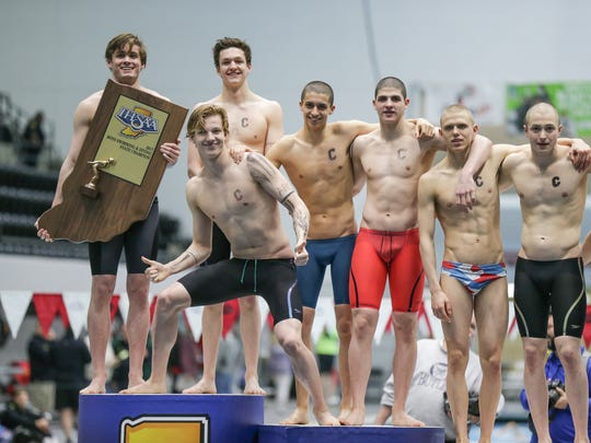 Carmel is awarded first place during the 2017 IHSAA High School Boys Swimming and Diving State Finals, held at the IUPUI Natatorium, Feb. 25, 2017.