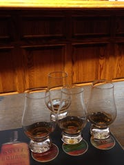 Sample of three bourbons and a rye whiskey at Stitzel-Weller Distillery in Shively outside Louisville await tasting following a tour of the historic facility.