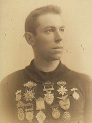 Terry Andrae, park namesake, wearing many of the medals he won racing High Wheel bicycles between 1885 and 1892.