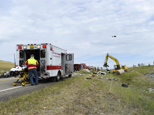 Emergency personnel work at the scene of a fatal collision