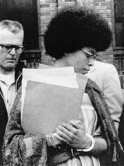 In this April 25, 1977 file photo, Joanne Chesimard, a member of the Black Panther Party and Black Liberation Army, leaves Middlesex County courthouse in New Brunswick, N.J.  Now known as Assata Shakur, she was convicted in 1977 of killing a New Jersey state trooper four years earlier, in a case that drew international attention. She was sentenced to life in prison but escaped. She wound up in Cuba in the 1980s and like other fugitives with political asylum here, once was living so openly in Havana that her number was listed in the phone book.