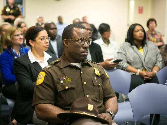 Col. Vaughn Bond Jr., chief of the New Castle County Police Department, listens to an announcement by County Executive Matt Meyer about the county government's efforts to ensure the safety and security of all residents.