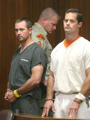 Former Kern County sheriff's deputies Logan August, right, and Derrick Penney appear in court in 2018.