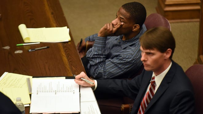 V'Nell Miskell, 27, sits next to his attorney Robert Whitacre, right, in his trial on first-degree murder and conspiracy in the death of 20-year-old Johnnie Cooper from 2014.