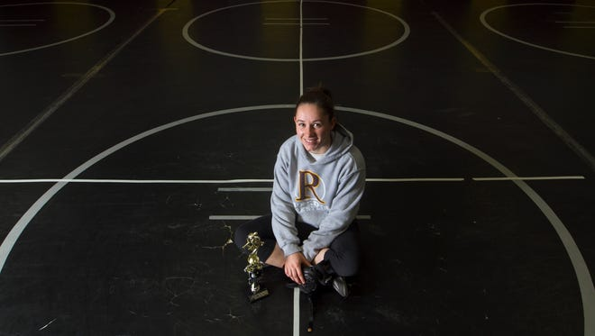 Riverdale's Mackenzie More won the girls wrestling state championship in the 132-pound weight class in her first full season as a wrestler.