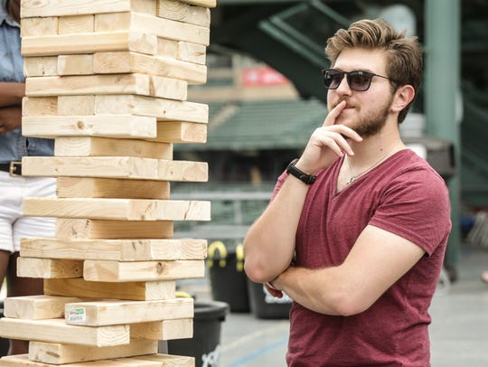 Watch your neighbors compete in friendly games of skill, like giant Jenga, at the Cincinnati Neighborhood Games Finals Saturday at Yeatman's Cove.