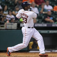Aug 26, 2014; Houston, TX, USA; Houston Astros designated hitter Chris Carter (23) hits a home run during the eighth inning against the Oakland Athletics at Minute Maid Park. Mandatory Credit: Troy Taormina-USA TODAY Sports