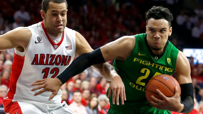 Oregon forward Dillon Brooks (24) drives past Arizona forward Ryan Anderson during the first half of an NCAA college basketball game, Thursday, Jan. 28, 2016, in Tucson, Ariz.