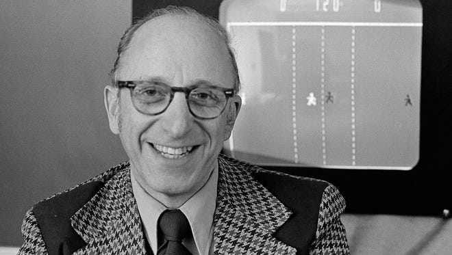 In this Feb. 3, 1977, photo, Ralph Baer, an engineer for Sanders Associates of Nashua, N.H., is seen in front of his TV hockey game.