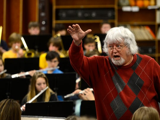 Fred Wenger, music teacher at East Middle School, works with his students.