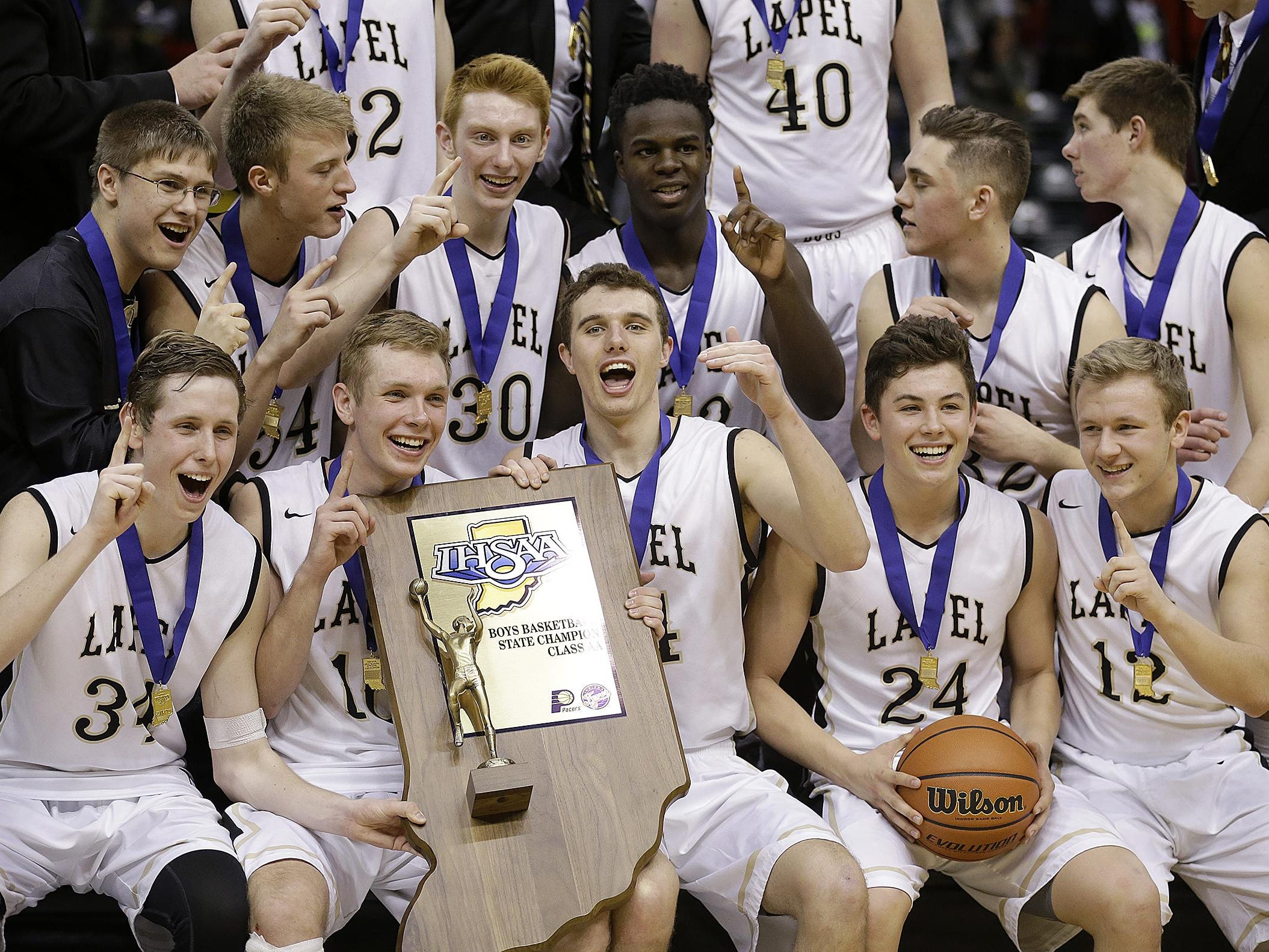 The Lapel Bulldogs celebrate their win in the IHSAA 2A Boys Basketball State Final game Saturday, Mar 26, 2016, afternoon at Bankers Life Fieldhouse. The Lapel Bulldogs defeated the Howe Hornets 59-37.