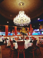 LouRonzo's dining room has an immense, sparkling chandelier.