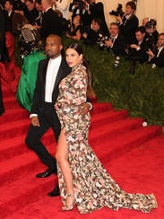 Kim Kardashian and Kanye West attend The Metropolitan