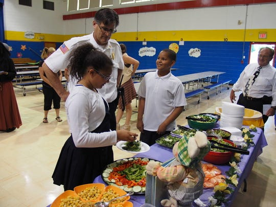 Chief Dooley talks with students as they make their salads.