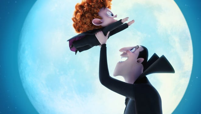 """Dennis (Asher Blinkoff) and Dracula (Adam Sandler) in Columbia Pictures and Sony Pictures Animation's """"Hotel Transylvania 2."""""""