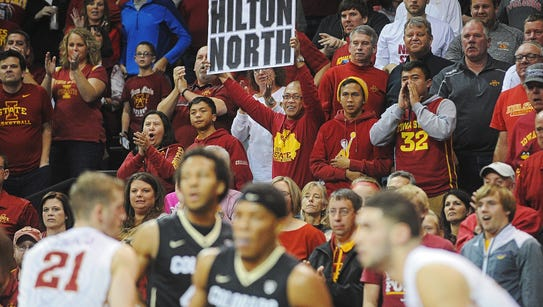 Iowa State fans cheer on their team during a men's