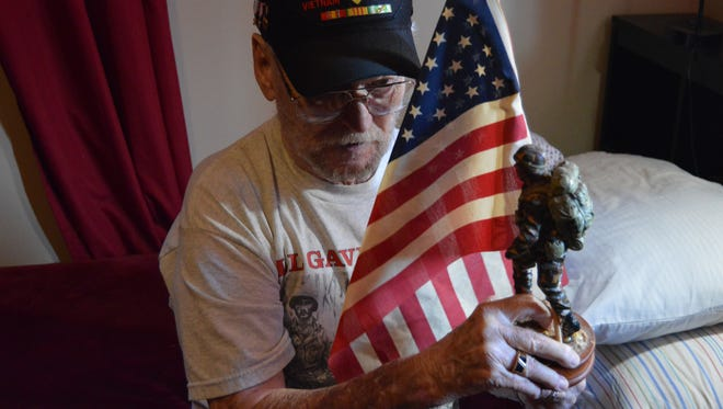 Wearing his favorite 'Vietnam veteran' hat, command sergeant major (ret.) Douglas Mann shares a recollection of his time in the Army. He keeps memorabilia and awards in a special room in his house, which he calls 'the man cave.'