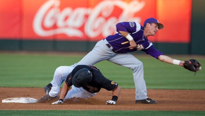 ASU First baseman Joey Bielek, 5, steals second under Tennessee Tech's second baseman Jake Farr, 1, at Phoenix Municipal stadium in Friday April 24, 2015 in Phoenix.