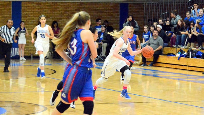 Carlsbad's Carsyn Boswell leads a fast-break attempt after getting a steal in the first quarter Friday.