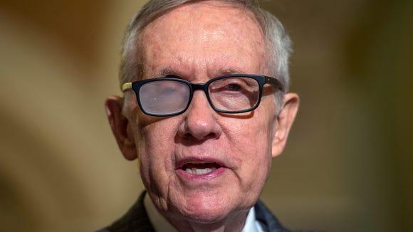 Senate Minority Leader Harry Reid, D-Nev., spoke to reporters on Capitol Hill in March.  (Molly Riley, AP)