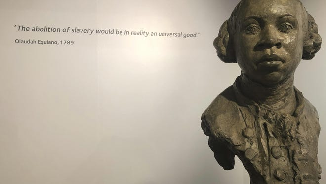 In this Nov. 24, 2019 photo, a sculpture of former slave and later abolitionist, writer Olaudah Equiano by London based artist Christy Symington, sits on display at the International Slavery Museum in Liverpool, England, Britain. Activists and towns in the U.S. are left wondering what to do with empty spaces that once honored historic figures tied to racism as statues and monuments fell in June 2020. The Equiano image has been suggested as a replacement.