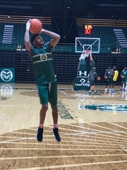 CSU guard J.D. Paige, sidelined with a broken hand