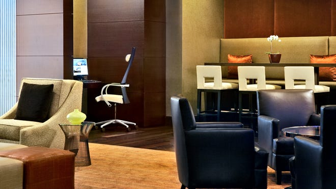 Hotel common areas such as the Regency Club at the Hyatt Regency Chicago are getting nicer, but many business travelers prefer to work in their rooms.