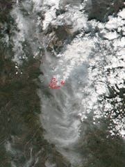 This daytime view of the Fort McMurray Wildfire in Alberta Canada was captured by the VIIRS instrument aboard NASA-NOAA's Suomi NPP satellite on May 4. Hotspots, indicating fires are outlined in red.