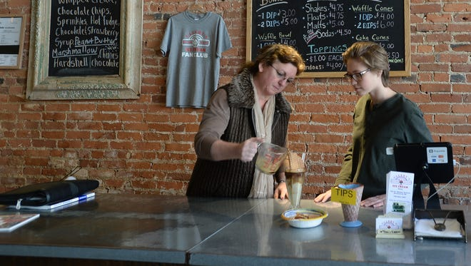 Tammy Ullery, left, teaches how to make an ice cream treat Wednesday, March 2, 2016, at Ullery's Ice Cream inside Roscoe's of the Depot District in Richmond.