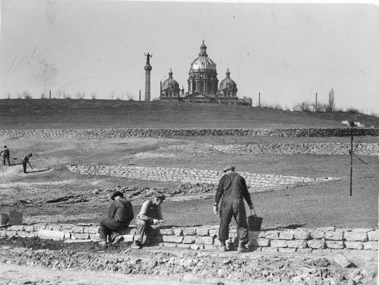 Men work on the State Capitol grounds in 1939.