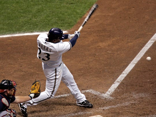 Rickie Weeks connects for a run scoring triple during