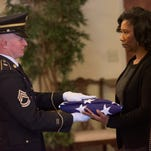 Cassandra Coretta Cook is presented a flag at the funeral of her father, civil rights warrior Sam Cook, on Wednesday January 20, 2016 at E.G. Cummings Memorial Funeral Home in Montgomery, Ala.