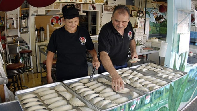 Longtime business owners Maria and Juan Contreras, owners of Juan & Maria's Empanada Stop, in 2007.