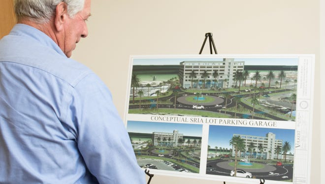 George Callender checks out drawings for a potential parking garage that are among the latest plans to help beach traffic congestion that were unveiled during a meeting at the Beach Community Church in Pensacola on Tuesday, October 25, 2016.