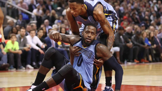 Nov 30, 2016; Toronto, Ontario, CAN; Memphis Grizzlies forward JaMychal Green (0) is picked up by forward Troy Williams (10) after being fouled against the Toronto Raptors at Air Canada Centre. The Raptors beat the Grizzlies 120-105. Mandatory Credit: Tom Szczerbowski-USA TODAY Sports