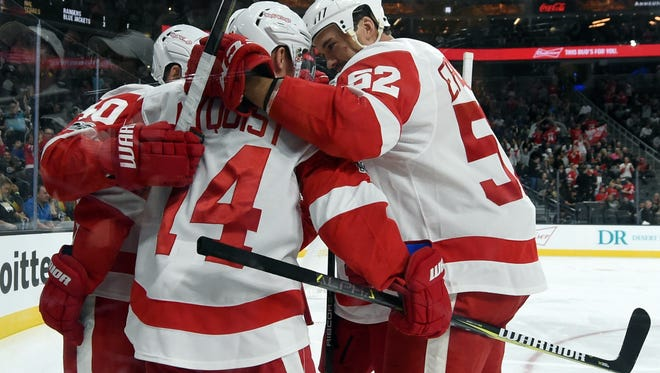 Red Wings celebrate after Gustav Nyquist scored a first-period goal against the Golden Knights on Friday, Oct. 13, 2017, in Las Vegas.