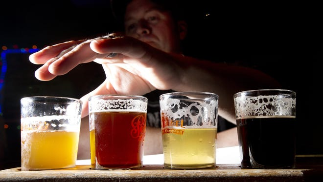 A bill going through the Legislature would allow brewers to give beer glasses to restaurants and bars