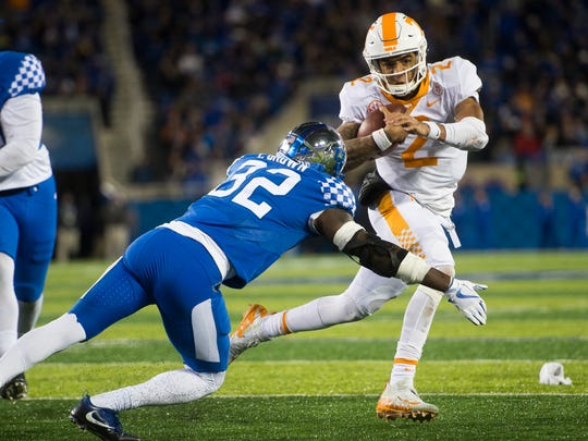 Tennessee quarterback Jarrett Guarantano (2) looks for room to run during Tennessee's game against Kentucky at Kroger Field in Lexington on Saturday, Oct. 28, 2017.