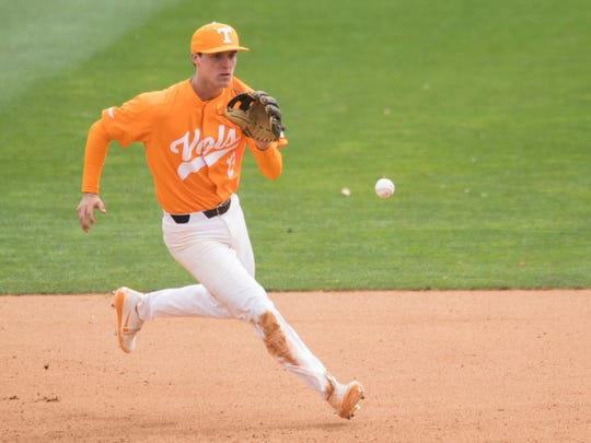 Tennessee's Andre Lipcius stops a ground ball in the 10th inning against Florida at Lindsey Nelson Stadium on Sunday, April 8, 2018.