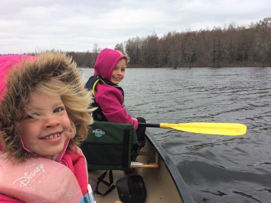 Hannah and Abby Wellendorf enjoy a winter canoe trip