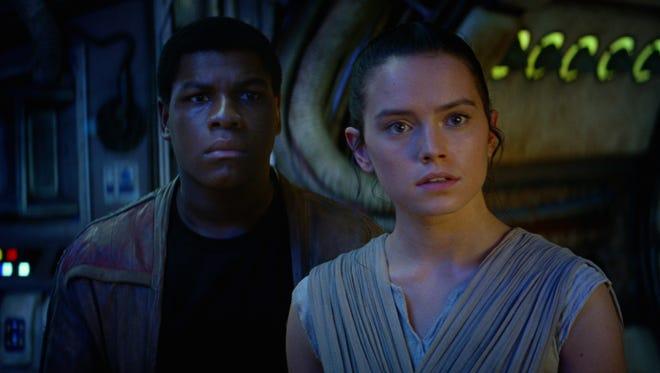 John Boyega (as Finn) and Daisy Ridley (Rey) in 'Star Wars: The Force Awakens.'