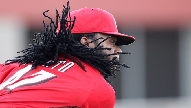 Reds starting pitchers Johnny Cueto throws during a live batting practice session.