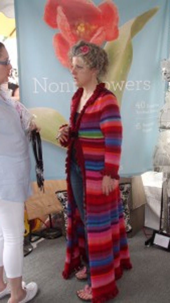Nora Bellows, in the striped coat, was busy all day, talking to adoring fans about her flowers and bags. Judging from the activity at the tent, her book, Noni Flowers, must be doing really well. MSWF 2012