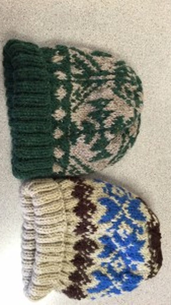 These are two of the hats I turned in yesterday. The green one is the one I finished Sunday night.