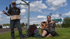 Hippie Jimmy and Pipes sing on 18th Avenue in Columbus