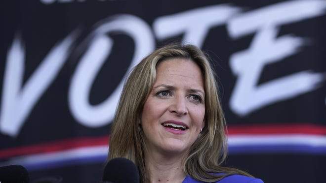 In this Sept. 24, 2020 file photo, Michigan Secretary of State Jocelyn Benson speaks in Detroit. A Michigan judge on Tuesday struck down Secretary of State Jocelyn Benson's directive banning the open carry of guns at polling places on Election Day.